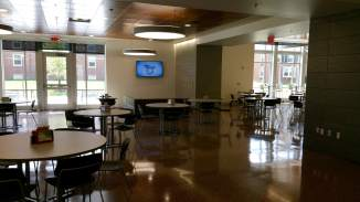 As you walk in, the dining hall opens up, revealing more seating, lounge areas and, of course, the serving area (to the right).