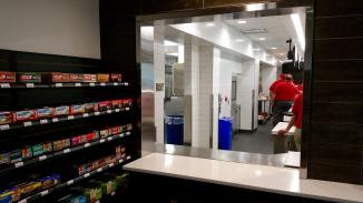 "You will be able to order cold deli and hot ""meals to go"" items by ordering at a kiosk in the market and then picking up your food here when it's ready."